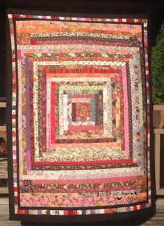 Paperi ja Kangas: torkkupeitto. Scrap quilt. Made from left over strings.