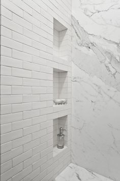 Marble & subway tiled shower
