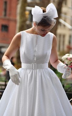 adorable...my mother's wedding dress was cotton dotted swiss! (sally dress from dressmefancy.com)