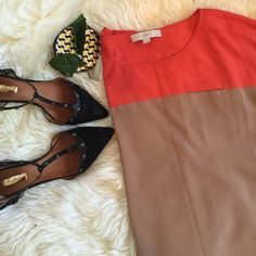 Color block blouse Ann Taylor loft tan and coral color block blouse, Small pocket detail on front. Worn a few times and it's in perfect condition! Great work wordrobe essential, easy to dress it up Size says medium petite but perfectly fits Small. Ann Taylor Tops Blouses