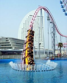 This is the coolest thing I've ever seen! Even though L would kill me if I dragged her there...Vanish roller coaster at Cosmo Land in Japan!