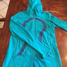 Vintage Lululemon Hooded zipper jacket Stretchy hoodie in a gorgeous teal, missing string, thumbholes, longer length. lululemon athletica Other