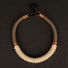 Necklace |  Nic wong and Daniel Loh.  Leather, crocheted cotton and beads