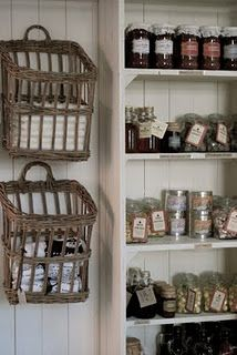 Baskets for holding towels. I also really love those simple white shelves.