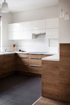 modern kitchen with wood laminate lower cabinets and white gloss upper cabinets
