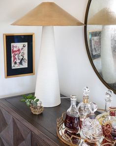 It's S H A P E S galore in this stunning living room corner by @kristinacurtisinteriors , featuring the Miramar Table Lamp by @kellywearstler @visualcomfortco ✨ with a tall ridged ceramic base and conical brass shade, add geometric statement to any space 🔥 Visual Comfort Lighting, Room Corner, Kelly Wearstler, Antique Brass, Table Lamp, Base, Shades, Sculpture, Living Room