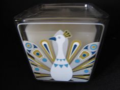 HAPPY CHIC BY JONATHAN ALDER Scented Peacock Candle Ret $15 #HappyChic.  Attention all peacock lovers!  Heavy glass jar can be used as a decorative holder when candle is spent.