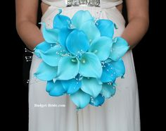 Beach Theme Calla lily wedding bouquet in turquoise and teal calla lilies. Perfect match for Davids Bridal Malibu and Spa bridesmaids dress colors