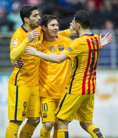 Lionel Messi of FC Barcelona celebrates with his teammates Luis Suarez and Munir El Haddadi of FC Barcelona after scoring his team's third goal during the La Liga match between SD Eibar and FC Barcelona at Ipurua Municipal Stadium on March 6, 2016 in Eibar