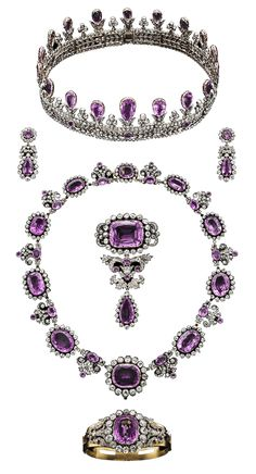 Prussia - The House of Hohenzollern Royal Pink Topaz Parure, Early 19th Century. Consisting of a tiara, a pair of pendant earrings, a necklace, a stomacher, and a hinged bangle, all composed of gold, silver, pink topaz, and diamonds.
