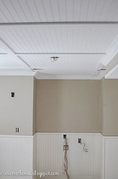 walls are painted with Pebbles by Pratt and Lambert in an eggshell.  The bottom bead board is sprayed with Benjamin Moore's White Dove in a satin