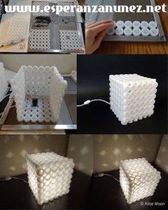 Lampara hecha con tapas de envases plasticos.