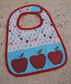I like the tab on this one better. Tutorial: Boutique Baby Bibs   A Spoonful of Sugar
