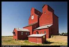 Black and White Picture/Photo: Red wooden grain elevator building. Immigration Canada, Classic Building, Vernacular Architecture, Water Tower, Farm Yard, Old Buildings, Black And White Pictures, Alberta Canada, Country Life