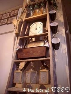 Rustic Prim...many uses for an old ladder in the kitchen...shelf unit, cup holder  such.