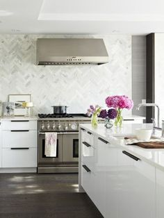 Carrara Herringbone Backsplash  Looks great with the white coutner top and cabinetry.    *Contempo stocks Carrara honed or polished in 4x12    For the counter:  Caesarstone in Blizzard or Pure White