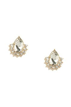 "Make sure your outfits are a ten out of ten with the Delicate Diligence Clear Rhinestone Earrings! Gold setting houses a large teardrop rhinestone above a semicircle of smaller clear rhinestones. Simple post backs. Earrings measure 0.75"" tall. Man made materials. Imported."