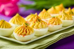 Creamy Deviled Eggs by afoodcentriclife: Deviled eggs are equally welcome at a spring dinner or a summer barbecue.  Most everyone loves them. And the fun part is you can give them your own style and flavor by how you garnish them.