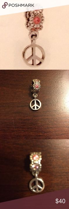 PANDORA PEACE SIGN CHARM Pandora authentic & retired peace sign charm in silver with pink stones..like new..refer to pics.. Pandora Jewelry