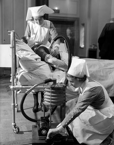 Nurses practice operating a respiratory jacket that performs a similar function to an iron lung, circa medical treatment Bizarre images of medical treatments through history, Vintage Nurse, Vintage Medical, Hip Massage, Medical Photography, Medical Photos, Old Hospital, Rare Historical Photos, Medical Illustration, Medical History