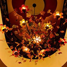 12 arm flower, bloom chandelier made of copper and resin.