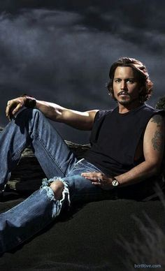 Johnny Depp...damn. Look at the arms. Mmmm