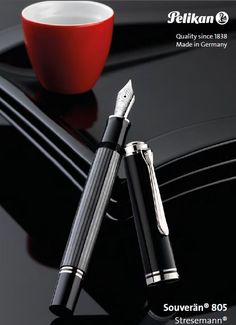 Pelikan M805 Stresemann To officially acknowledge and honor this legend,Pelikan has now named the latest addition to the standard collection,the Souverän with elegant stripes in anthracite, the Stresemann. For the black, finely turned pieces, high-quality resin was used. The clip and the rings are palladium plated. The nib is 18 carat gold and then completely rhodinized to obtain a silver sheen. Every writing instrument is mounted by hand and carefully checked to fulfill the strictest…