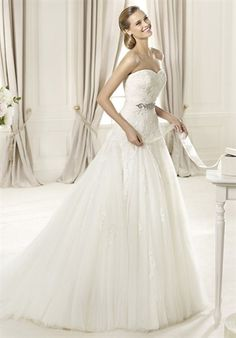 Tulle and lace    PRONOVIAS  DAGEN    Silhouette: A-Line  Neckline: Sweetheart  Waist: Empire  Gown Length: Floor  Train Style: Attached  Train Length: Chapel  Sleeve Style: Strapless  Fabric: Tulle  Embellishments: Embroidery  Color: Ivory  Size: 4 - 24  Price: $$$