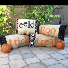 Burlap Halloween pillows with fabric borders.