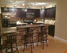 Contemporary kitchen, with dark cabinets