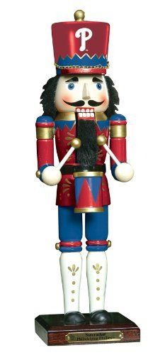 "MLB Philadelphia Phillies 14-Inch Nutcracker 6th Edition by The Memory Company. $21.99. Team logo. Team colors. This officially licensed 14"" wooden nutcracker is painted in the team colors and dressed in the traditional top hat overcoat."