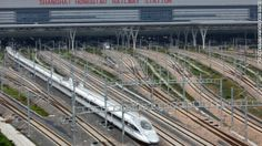 A CRH380A bullet train pulls out of the Hongqiao Station during one of its test runs in 2011 on the Beijing-Shanghai high-speed railway in C...