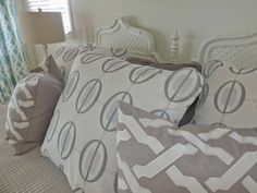 Birds Of A Feather: Beach House Reno incorporate gray/white linen pillows on this beautiful bed. #sponsored