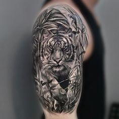 monochrome half sleeve and shoulder cap tiger tattoo