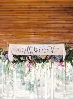 """Hanging wedding flowers - """"Worth the Wait"""" banner/sign: http://www.stylemepretty.com/vault/search/images/Decor"""