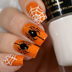 Can't stop with Halloween nail art!!!  I hate spiders, but when they have a holo background and are staying put on my nails I don't mind them as much!      Products used: Orange polish: And All I Loved, I Loved Alone part of the POE collection by @differentdimensionus Halloween Party 01 plate from @pueencosmetics Black Jack and Pure White stamping polishes by @pueencosmetics   Tutorial Later #pueen #sponsored #halloweennails