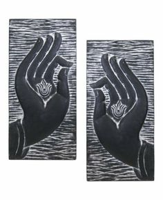 Buddha Hands Wall Panel Set by Buddha Groove. $108.00. Black and white textured finish, Each panel measures 29.5 x 13.75 inches. Buddha hands wall art. Made in Vietnam. Each panel weighs about 5 pounds, Includes hooks for easy hanging. Set of two panel designs, Made of cast resin. This elegant wall panel set encourages peaceful contemplation and relaxation within your surroundings. The hands of Buddha are displayed here in classical formation, with the thumbs and forefinge...