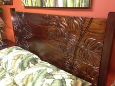 Close up of hand carved detail on headboard. Master bedroom furniture