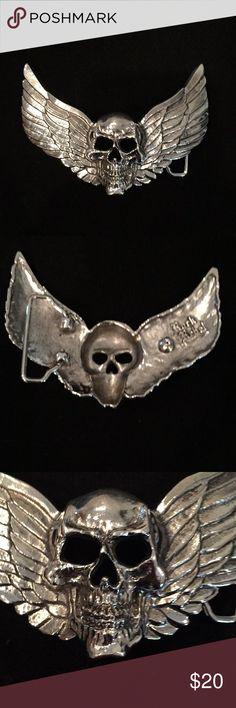 "Rock Rebel Skull Belt Buckle 4"" Wide Rock Rebel skull with wings belt buckle. Attaches easily to any leather belt that snaps off buckles. Does not include belt. Peg hooks into belt buckle holes. Buckle is silvertone, 4"" wide and 3"" high, fits up to 1.5"" belt. New without tags. Awesome! Rock Rebel Accessories Belts"