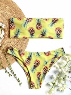 Stand out in this feminine sexy two piece bikini swimsuit, which includes a structured bandeau top and a swim brief. It has a straight cut edge to the top, and the swim bottoms in a moderate coverage. Pineapple print throughout for an attractive look.  #Zaful #Swimwear #Bikinis