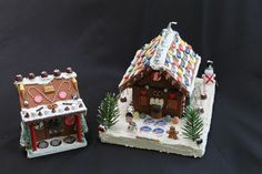 Gingerbread house made of styrofoam or wood. Decorated with handmade polymer clay candies.  www.uniquedesignsbyjudi.com