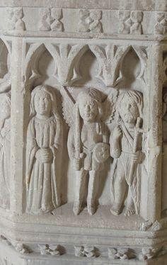 Taunton St. James: the font - two saints flanking the Archangel Michael.