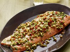 Cook up this Roasted Salmon topped with a delicious Walnut-Pepper Relish for your next gathering!