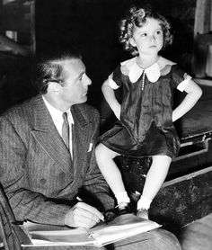 Gary Cooper and Shirley Temple on the set of Now and Forever, 1934.