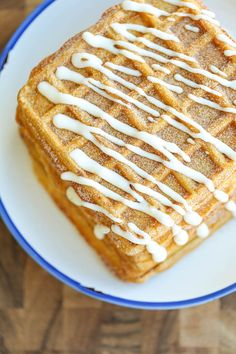 Light, fluffy, melt-in-your mouth pumpkin waffles coated in buttery cinnamon sugar and drizzled with a cream cheese glaze.