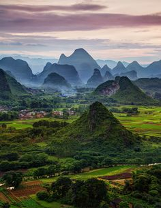 I love these karst mountains so much. They look good almost any time of the day, but perhaps they look best when there is a touch of fog or mist in the air. The whole place is surreal enough, but when it hits this state, the fantasy level just goes off the charts! - Guilin, China - Photo from #treyratcliff Trey Ratcliff at http://www.StuckInCustoms.com