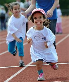 Deanne Federico, 9, a third grader at the Bennett-Hemenway School in Natick, takes the lead in the 50 meter run during the Natick School Day Games at Natick HIgh School. Deanne has Achondroplasia, a form of dwarfism. Read more: http://tinyurl.com/7qht2o5