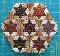 Done by Jo Morton.  Like her outer triangle piecing.  Maybe finish mine this way.  More inspiration.