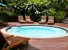 Inground Pool Ideas For Small Yards small fiberglass swimming pools design with gray iron patio furniture sets and travertine tiles ideas Mini Pools For Small Backyards Fun And Excitement For The Whole Family Inground Pool