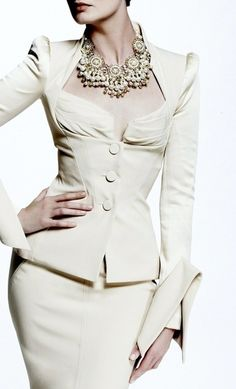 I love classy and sexy white suits with statement jewels